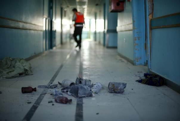The remains of a tank shell, which police said was fired by Israeli troops, are seen on the fourth floor of Al-Wafa rehabilitation hospital in the east of Gaza City July 16, 2014. REUTERS/Mohammed Salem