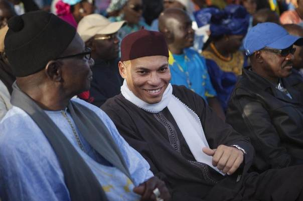 Karim Wade (C), son of Senegal's former president Abdoulaye Wade, attends a rally by his father's political party Parti Democratique Senegalais (PDS) in Dakar, Senegal, December 6, 2012. REUTERS/Joe Penney
