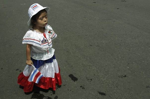 A girl dressed in the colours of Costa Rica's national flag is pictured during a parade commemorating Costa Rica's Independence Day in San Jose September 15, 2013. REUTERS/Juan Carlos Ulate