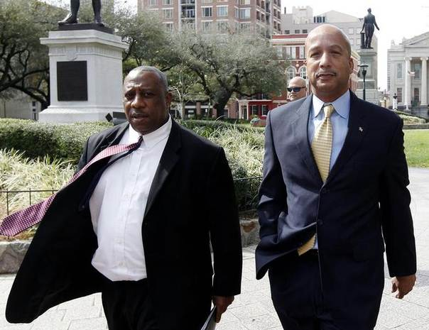 Former New Orleans Mayor Ray Nagin (R) and his attorney Robert Jenkins arrive at court in New Orleans February 20, 2013. REUTERS/Jonathan Bachman