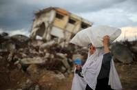 U.N. and Palestinians appeal for aid, amid Palestinian attacks