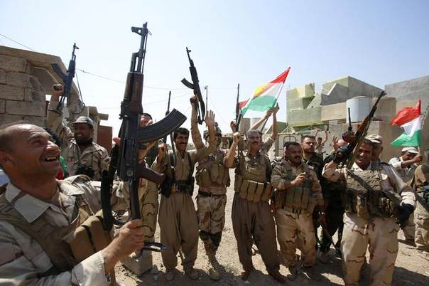 Kurdish peshmerga forces celebrate after taking control of Sulaiman Pek, in the northwest of Tikrit city, from Islamic State militants. Picture September 1, 2014. REUTERS/Youssef Boudlal