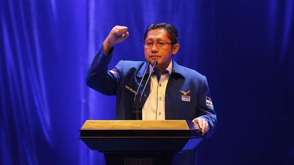 Then chairman of the Democratic Party Anas Urbaningrum gestures as he makes a speech during the opening of the party's two-day national coordination meeting in Sentul, Bogor of Indonesia's West Java province July 23, 2011. REUTERS/Supri