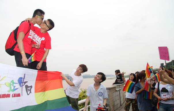 A gay couple kiss during a demonstration to mark the International Day Against Homophobia and Transphobia in Changsha, Hunan province, on May 17, 2013. REUTERS/Stringer