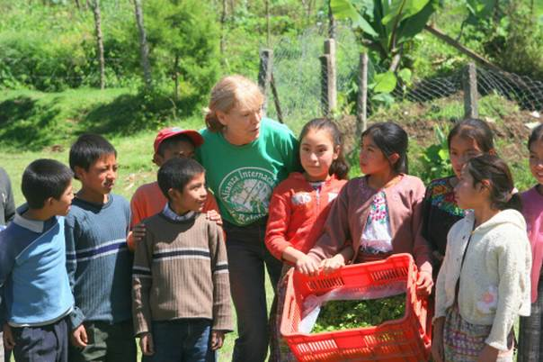 Anne Hallum of the Alliance for International Reforestation joins Guatemalan children participating in an agroforestry project. Picture credit AIR Guatemala