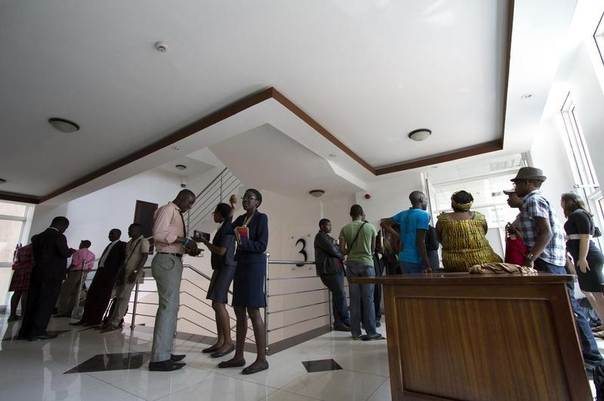 Gay and human rights activists wait outside the courts before filing a constitutional petition against a new anti-homosexuality law, in Uganda's capital Kampala ,March 11, 2014. REUTERS/Edward Echwalu