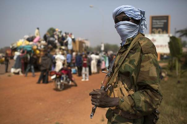 A Chadian soldier who is part of the African Union (AU) peacekeeping mission in the Central African Republic keeps guard during a repatriation exercise of people by road to Chad in the capital Bangui January 16, 2014. REUTERS/Siegfried Modola