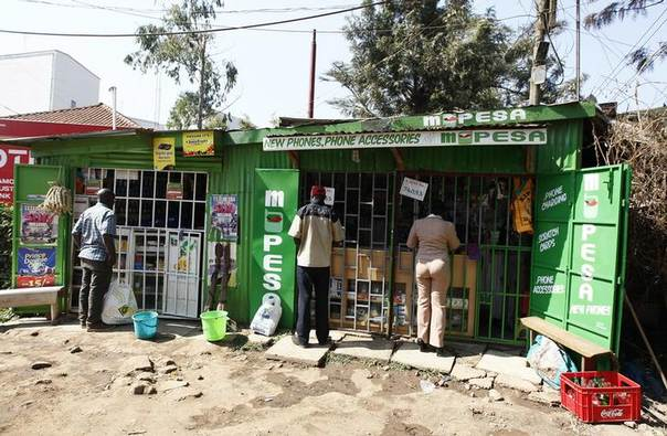 Customers are seen at mobile money transfers kiosks, known as M-Pesa agents, near Ngong township in the outskirts of Kenya's capital Nairobi July 15, 2013. Picture July 15. REUTERS/Thomas Mukoya