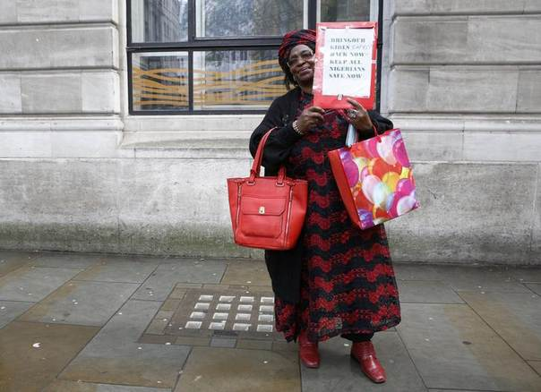 A protestor holds a sign as she demonstrates against the kidnapping of school girls in Nigeria, outside the Nigerian Embassy in London May 9, 2014. REUTERS/ Olivia Harris