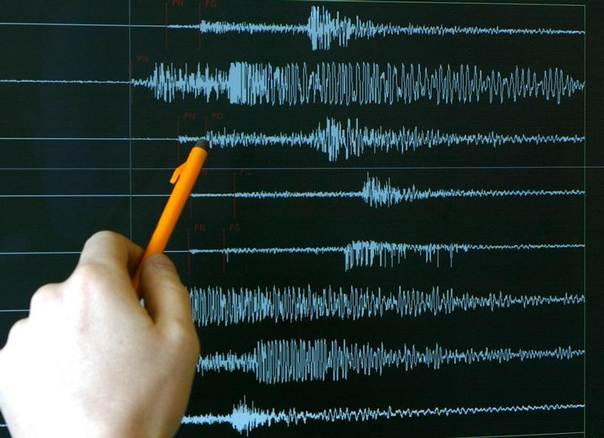 In this 2004 file photo an unidentified technician at the French National Seism Survey Institute in Strasbourg points at a graph registered during an earthquake. REUTERS/Vincent Kessler VK/AA