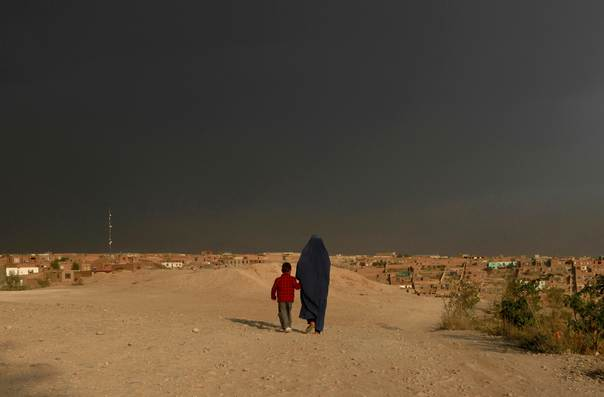 An Afghan woman walks with her child in Kabul, on Oct. 18, 2012. REUTERS/Mohammad Ismail