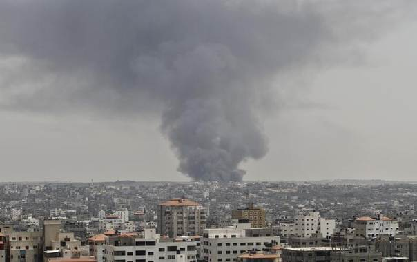 Smoke rises following what police said was an Israeli tank's shelling that hit the industrial area in the east of Gaza City July 12, 2014 REUTERS/Ahmed Zakot