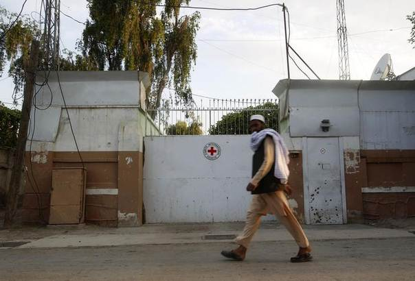 A man walks past the front gate of the International Committee of the Red Cross (ICRC) office in Jalalabad province June 2, 2013.  REUTERS/Parwiz