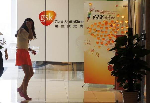 In this 2013 file photo, an employee walks inside a GlaxoSmithKline (GSK) office in Shanghai REUTERS/Stringer