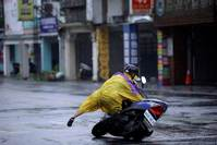 Taiwan's third typhoon of the month kills at least four
