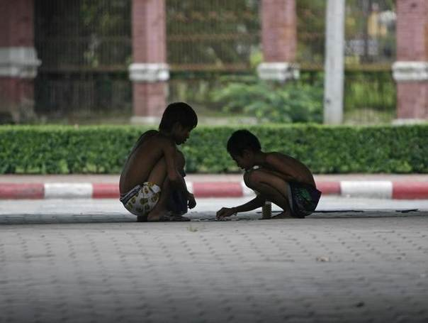 Homeless children play on a street in Bangkok in this file photo. REUTERS/Chaiwat Subprasom