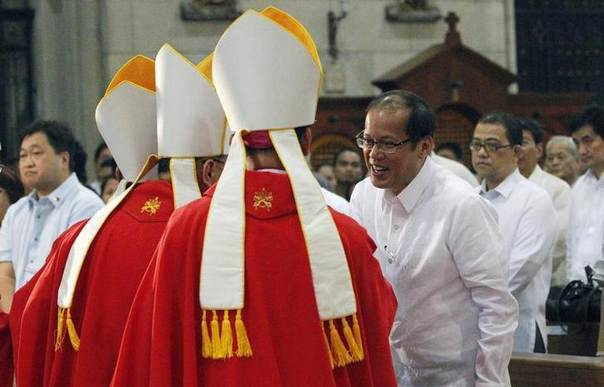 In this 2010 file photo, Philippine President Benigno Aquino III (R) greets bishops of the Roman Catholic Church during a first ever solemn celebration of a Mass of the Holy Spirit, known as 'Red Mass', inside a cathedral in Manila REUTERS/Romeo Ranoco