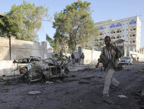 A man walks past the scene of an explosion that occurred Wednesday night outside Jazira hotel in Mogadishu, January 2, 2014 REUTERS/Omar Faruk