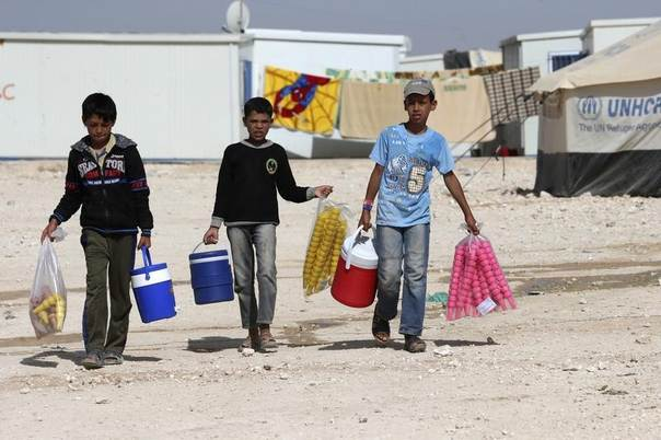 yrian refugee children sell ice cream at Al Zaatri refugee camp in the Jordanian city of Mafraq, near the border with Syria, May 4, 2014. EUTERS/Muhammad Hamed