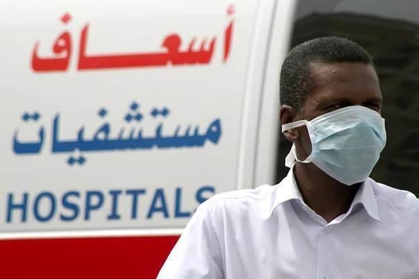 A man wearing a surgical mask walks near a hospital in Khobar city in Dammam, Saudi Arabia, May 21, 2013. REUTERS/Stringer