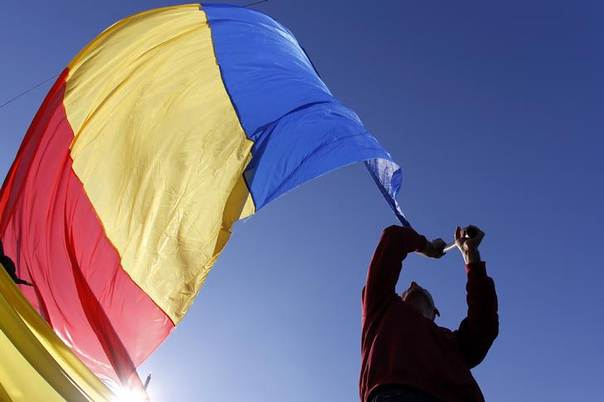 In this 2013 file photo, a man waves a Romanian national flag during a march in downtown Bucharest REUTERS/Bogdan Cristel