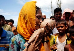 Rohingya refugee woman Hamida mourns after her 40-day-old son died when a boat capsized in the shore of Shah Porir Dwip, Bangladesh