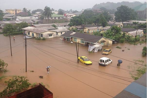 Heavy floods submerge houses in the Isokolo coastal area in Limbe, Cameroon. TRF/Elias Ngalame Ntungwe )