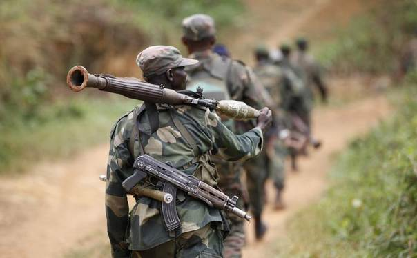 Democratic Republic of Congo military personnel (FARDC) patrol near Beni in North-Kivu province in this photo from December 31, 2013. REUTERS/Kenny Katombe