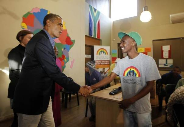 U.S. President Barack Obama greets a youth as he tours the Desmond Tutu HIV Foundation Youth Centre in Cape Town, June 30, 2013. REUTERS/Jason Reed
