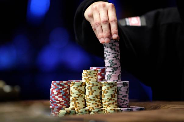 In a 2010 file photo, Jonathan Duhamel of Canada stacks chips at the World Series of Poker Main Event in Las Vegas, Nevada. REUTERS/Las Vegas Sun/Steve Marcus
