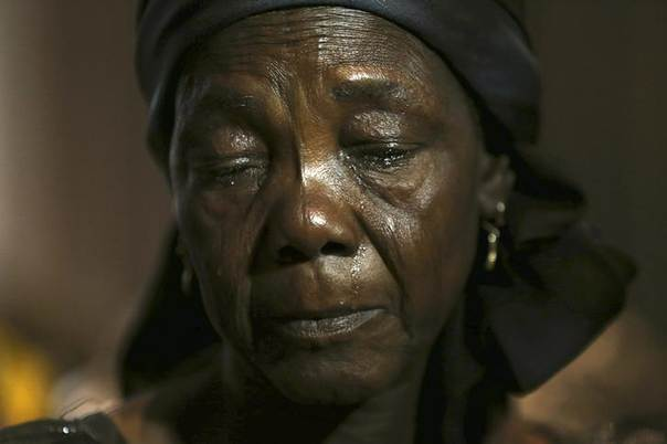Hauwa Nkaki, mother of one of more than 200 girls abducted in the remote village of Chibok, cries as she reacts during a news conference on the girls in Lagos June 5, 2014. REUTERS/Akintunde Akinleye