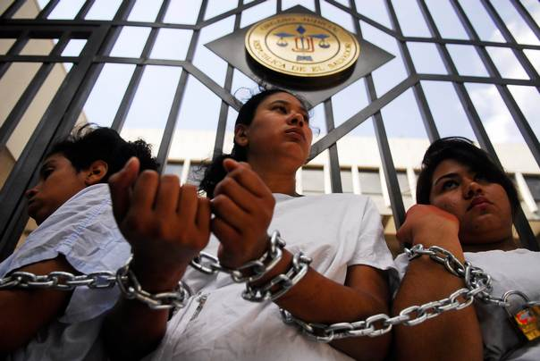 Women stand chained together outside the Supreme Court in San Salvador, on May 15, 2013, during a protest in support of a 22-year-old woman identified as Beatriz who requested an abortion because she suffers from diseases such as lupus and because the foetus she carried was suffering from abnormal development of the brain and skull. REUTERS/Ulises Rodriguez