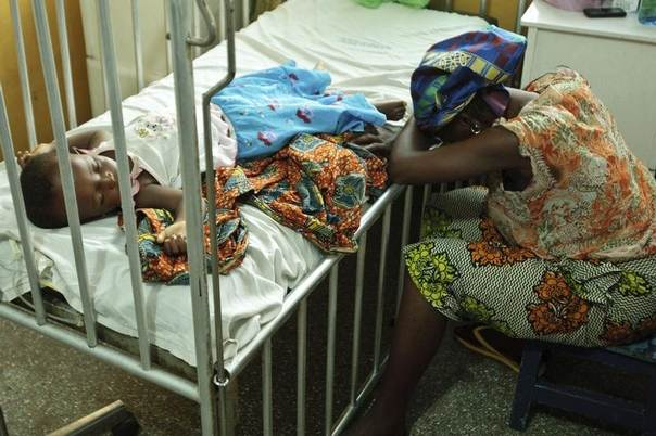 In this 2012 file photo a woman rests her head against the bed where her 21-month-old daughter suffering from malaria and diarrhoea rests at the Princess Marie Louise Children's Hospital in Accra, Ghana. REUTERS/GAVI/Olivier Asselin/Handout
