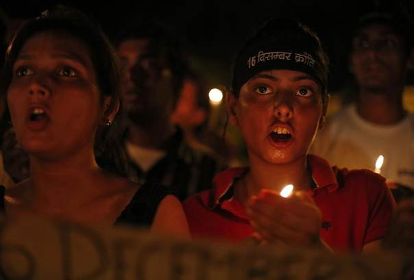 Demonstrators shout slogans during a candlelight vigil after four men convicted of raping and murdering a 23-year-old woman in Delhi were sentenced to death September 13, 2013. REUTERS/Mansi Thapliyal