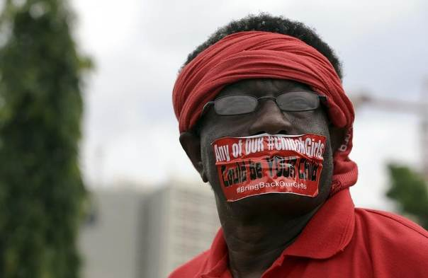 A demonstrator looks on during a rally in Abuja held to mark the 120th day since the abduction of 200 schoolgirls by Boko Haram, August 12, 2014. REUTERS/Afolabi Sotunde