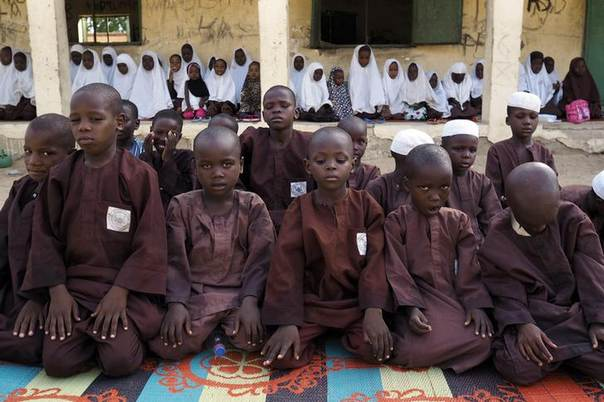 Boys and girls pray at an Islamic school in Maiduguri, Nigeria, May 24, 2014. REUTERS/Joe Penney