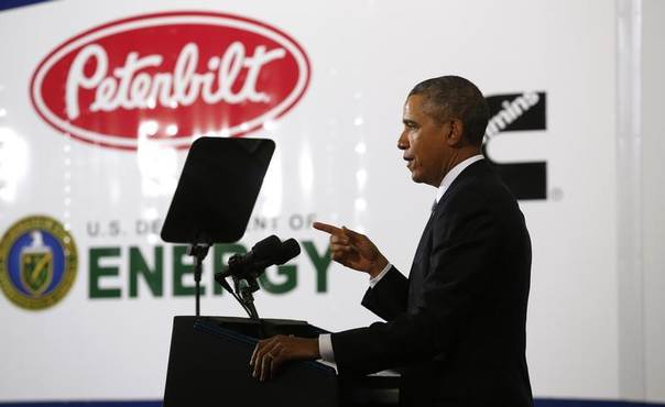 U.S. President Barack Obama delivers remarks on the economy and fuel standards at the Safeway Distribution Center in Upper Marlboro, Maryland, Feb. 18, 2014. REUTERS/Kevin Lamarque