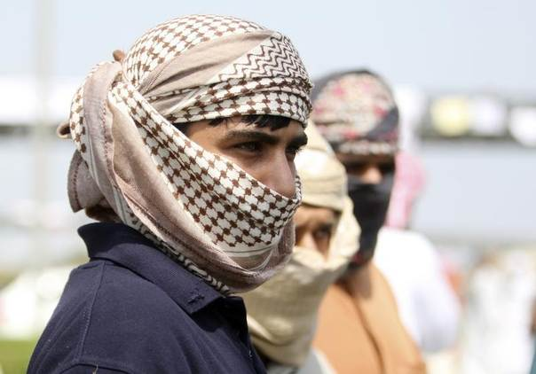 A protester looks on after Omani troops disperse a crowd demanding jobs and political reforms during a demonstration in the northern industrial town of Sohar in Oman March, 2011. REUTERS/Jumana El-Heloueh