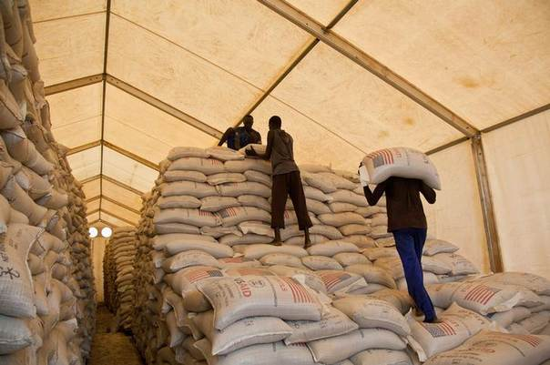 In this 2012 file photo, men stack bags of lentils in the United Nations World Food Programme (WFP) warehouse at the Jamam refugee camp in South Sudan's Upper Nile REUTERS/Adriane Ohanesian