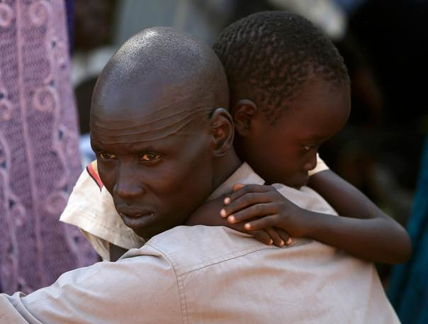 A man and his son who have fled fighting to a UN compound in Juba, South Sudan, December 19, 2013. REUTERS/Goran Tomasevic