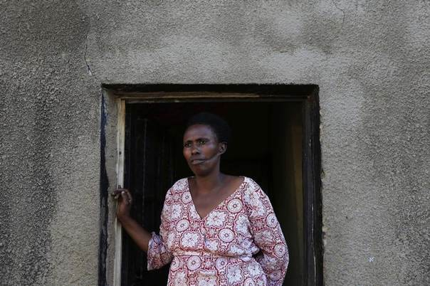 Alphonsine Mukamfizi, 42, who miraculously survived three attempts on her life and had to fake death in order to survive, with a deep cut on one side of her face, looks on at her home in Nyamata, a small town outside of Rwandan capital Kigali April 4, 2014. The rest of her 11 family members were all killed on those occasions during mass killings in the 1994 genocide. REUTERS/Noor Khamis