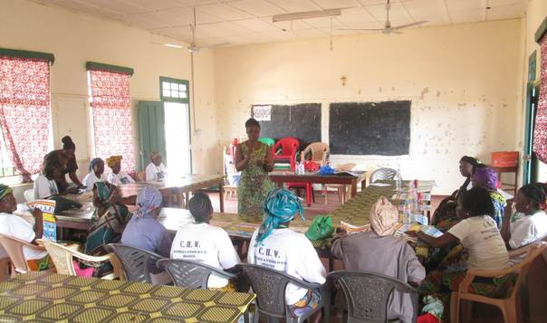 Field Officer Baindu Saidu trains Traditional Birth Attendants to help raise awareness about ebola and how to prevent the disease from spreading. Photo by: Concern Worldwide