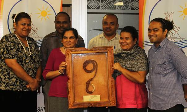 Representatives of PDF receiving the PILAR award during the 6th Pacific Platform for Disaster Risk Management, Suva, Fiji, in June 2014. Left to right (back row) Nancy Musukasau, Bimal Narayan, Neori Lagi (and front row) Lanieta Matanatabu, Angeline Chand, Shane Antonio © Pacific Disability Forum