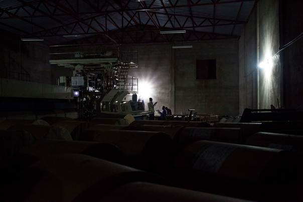 Workers are seen during a print run of The Citizen newspaper late at night in a warehouse in Juba, South Sudan, on May 22, 2012. REUTERS/Adriane Ohanesian