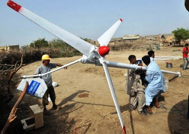 Local engineers prepare to install a wind turbine to electrify a coastal village near Kharo Chan in Pakistan's southern Thatta district. TRF/Saleem Shaikh