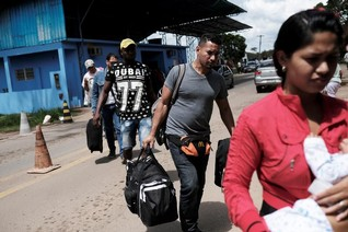 Rush to house record number of Venezuelan refugees as rainy season looms in Brazil's north