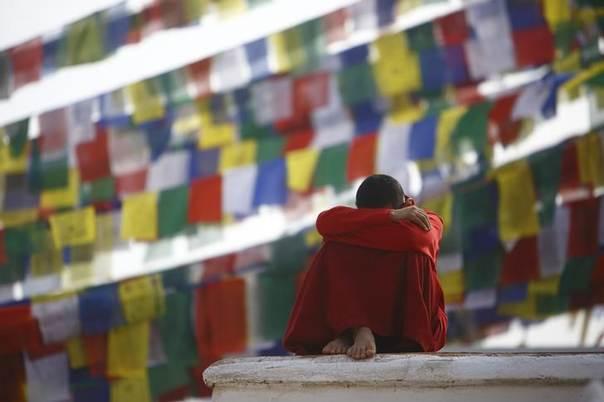 A monk rests at the premises of Boudhanath Stupa in Kathmandu March 10, 2014 REUTERS/Navesh Chitrakar