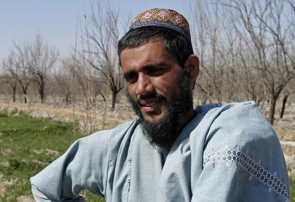 Sher Mohammad, one of the 65 prisoners released from Bagram prison, sits at his home at Zhari district, Kandahar province, February 23, 2014. REUTERS/Ahmad Nadeem