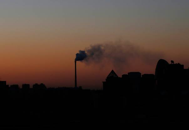 Smoke rises from a chimney of a cogeneration plant in Beijing on November 25, 2013. REUTERS/Kim Kyung-Hoon
