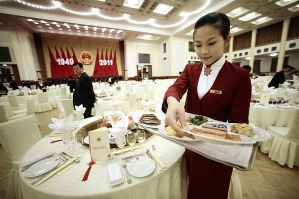 In this 2011 file photo, an attendant prepares for a reception marking the 62nd anniversary of China at the Great Hall of the People in Beijing REUTERS/Jason Lee